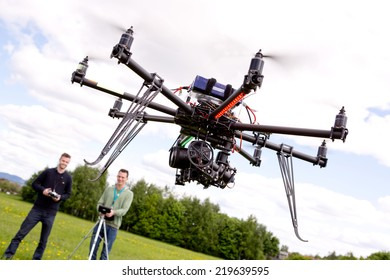 Photography UAV being operated by pilot and photographer