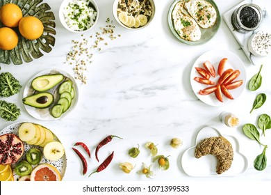 Photography of variuos bio fruits and vegetables on the marble table. Healthy food background with copy space for menu or slogan..