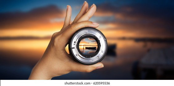 Photography view camera photographer lens lense through sunset sunrise cloud sky water lake concept - sunset at the pond with specular reflection