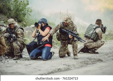 Photojournalist documenting war conflict. in the mountain. war, army, technology and journalist work concept.