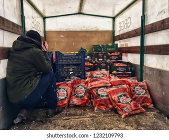 A photojournalist takes pictures in a market van, Thessoloniki, Greece, 02/11/17