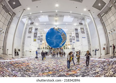 PHOTOKINA, COLOGNE - SEPTEMBER 19, 2014: people visit Photokina - World of Imaging, Top Event for the Trade and User, photo globe,  in Cologne, Germany.
