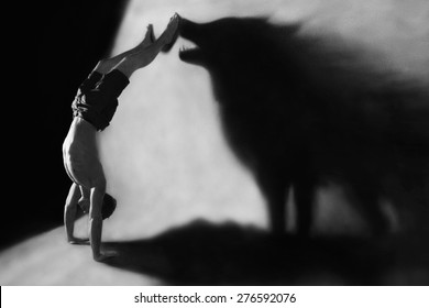 Photo-manipulation - handstand in studio with wolf shadow
