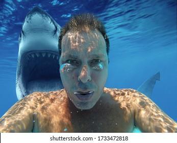 (photomanipulation)European man diving with shark. Scary selfie with shark under water. Shark behind his back with open jaw. Air bubbles rising in front of his face