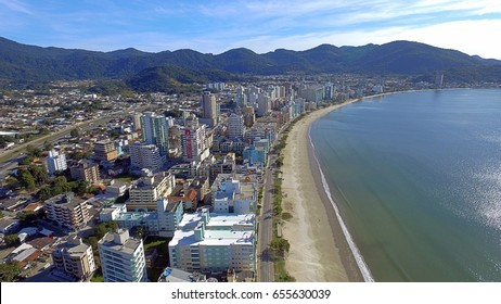 Photos areas with drone, beach of Itapema, Brazil, photos of the beach and building on the edge of the city, tourism in Brazil