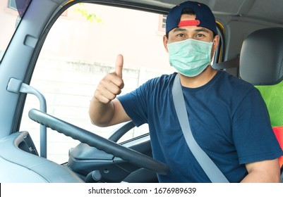 photos of Asian truck drivers wearing mask protect against dust and the spread of COVID 19 in the front of the car. Safety ideas for employees in the transportation business. And is a new normal life
