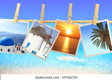 Photos of Greece hanging on a rope in front of the sea. Travel concept