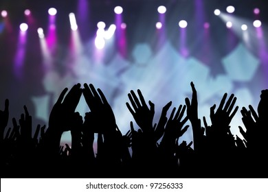 Photos of hands raised at rock concert, silhouetted against stage lighting.