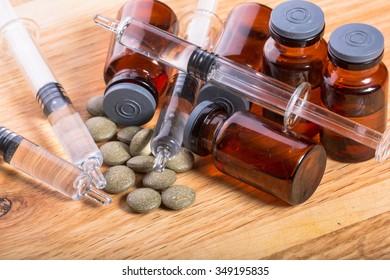 Photos health and medicine vials on wooden background