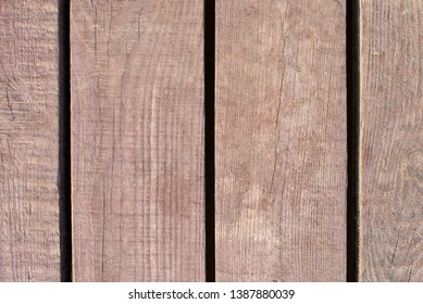 Photos of old smooth boards covered with sand, wood texture, background