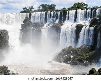 photos of San Martin island in the iguçu falls on the argentine side, shows a large amount of water falling in the falls