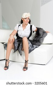 photosession of young pretty woman in white interior