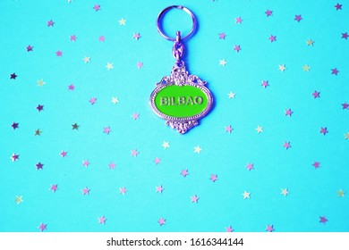 photoshoot set of a key ring and flakes on a blue pop background. Ideal for promotional campaigns.