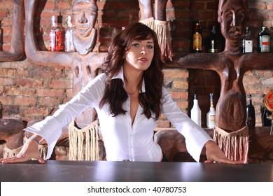 Photoshot of beautiful barmaid waiting order