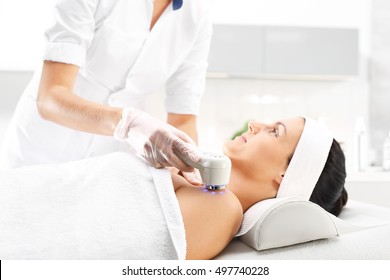 Phototherapy, cosmetic massage ultrasound. Light skin treatment, the woman in the beauty salon