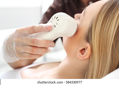Phototherapy, a woman in the beauty salon