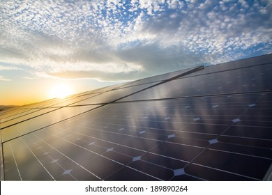 Photovoltaic cells on the background of beautiful cloudes