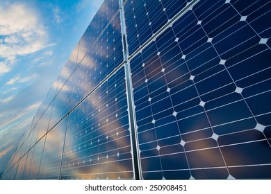 Photovoltaic cells on a background of a cloudy sky