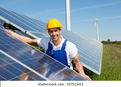 Photovoltaic engineer or installer installing solar panels