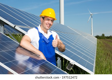 Photovoltaic engineer showing thumbs up at solar energy array