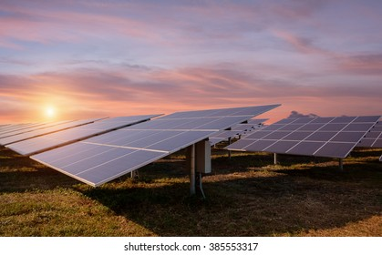 Photovoltaic industry solar energy panels and sunlight at sunset