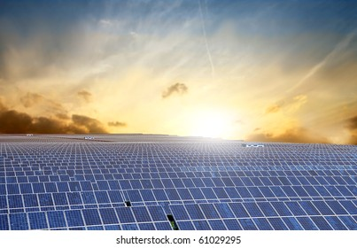 Photovoltaic installation with sunlight on the background