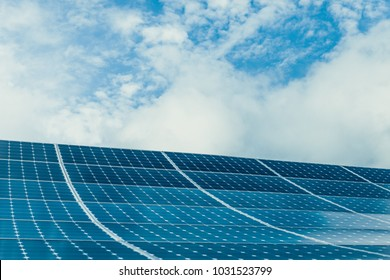 Photovoltaic modules of huge solar panels with clear blue sky on background