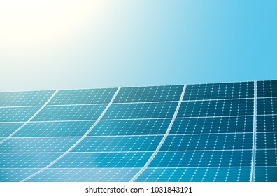 Photovoltaic modules of huge solar panels with sun and clear blue sky on background