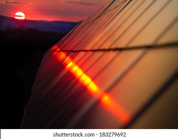 Photovoltaic modules on the background of a sunset