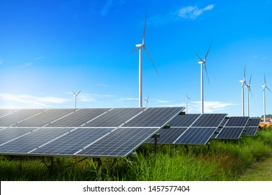 Photovoltaic modules solar power plant with wind turbines against and blue sky with cloud,alternative clean energy concept.