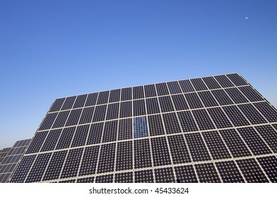 photovoltaic panel and blue sky with little moon