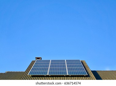 Photovoltaic panel on the roof of a residential building for environmental friendly energy production
