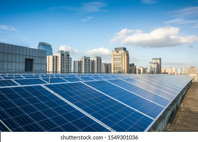 Photovoltaic panels in front of city background