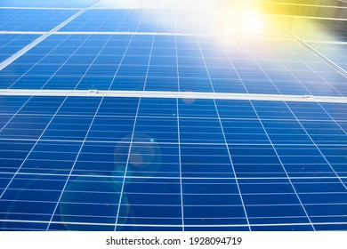 Photovoltaic panels on the roof of the building after cleaning and washing with water splashing  and cleaning products. Soft and selective focus.