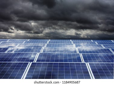 Photovoltaic panels under dark clouds before the storm