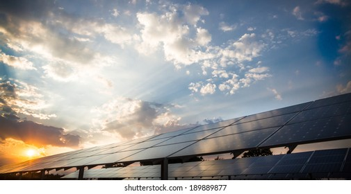 Photovoltaic power plant on the background of a sunset