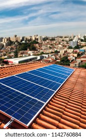 Photovoltaic power plant on the roof of a residential building on sunny day - Solar Energy concept of sustainable resources