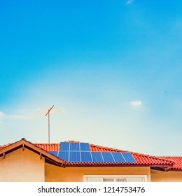 Photovoltaic power plant on the roof of a house on sunny day - Solar Energy concept of sustainable resources