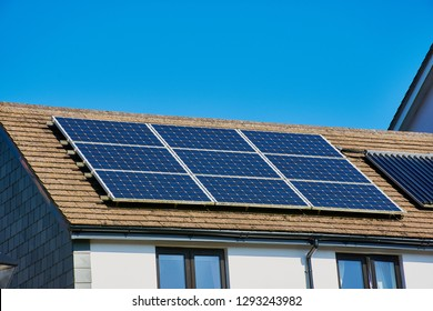 Photovoltaic power plant on the roof of a Cornish house on a sunny day - Solar Energy concept of sustainable resources