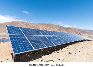 photovoltaic power station on tibetan plateau, closeup of solar energy panels with sunny sky