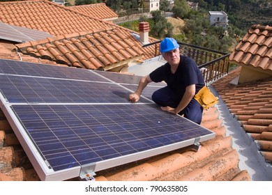 photovoltaic skilled worker fitting panels on a roof