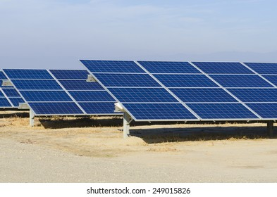 Photovoltaic solar collector panels set up in an ag area of southwest California