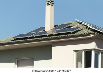 photovoltaic solar panels house roof sunny day