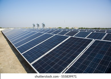 Photovoltaic solar panels on building roof, Regenerative energy system electricity generation, Maharshtra, India.