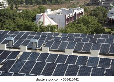 Photovoltaic solar panels on building roof, Regenerative energy system electricity generation.