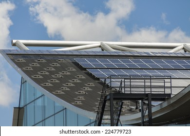 Photovoltaic solar panels on a roof for converting the solar energy of the suns radiant emissions to electricity in a sustainable alternative resource in an eco friendly power and energy concept