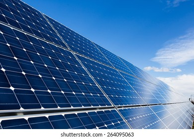 Photovoltaic solar panels and sky with few clouds