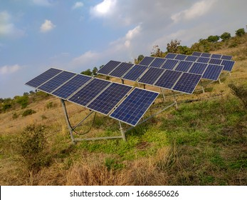 photovoltaic solar power panel on sky background, green clean Alternative power energy concept. Solar panals in farmland and field outdoor. Solar Power Station in the autumn Nature. Solar panals field