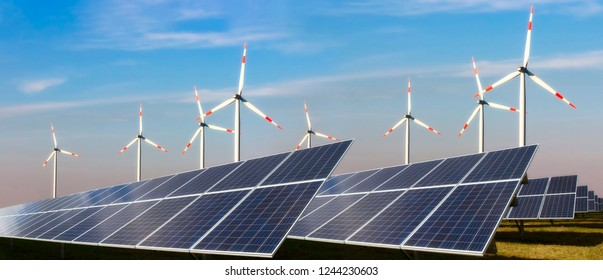 Photovoltaic system and wind turbine in front of blue sky