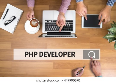PHP DEVELOPER man touch bar search and Two Businessman working at office desk and using a digital touch screen tablet and use computer, top view